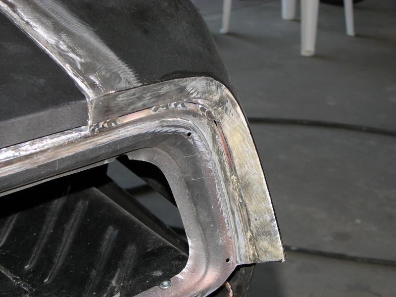 Tail panel welds to rear quarter before fiberglass matting.