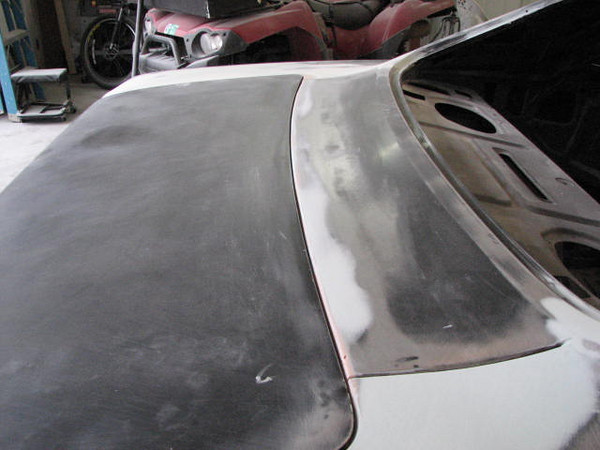 Dutchman panel and top of trunk lid gap adjusted/repaired.