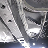 New Seam sealer applied to inside of passenger side rear frame rail and underside of new trunk floor pan.