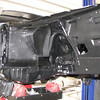 New undercoating; passenger side; front inner fender.