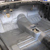 Front passenger compartment floor sprayed with Rust Bullet.
