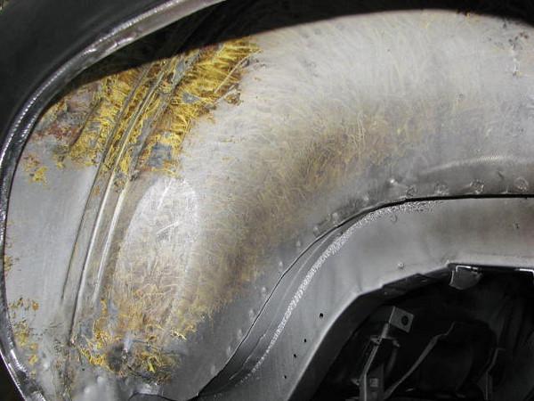 Passenger's side rear fender well sans undercoating.