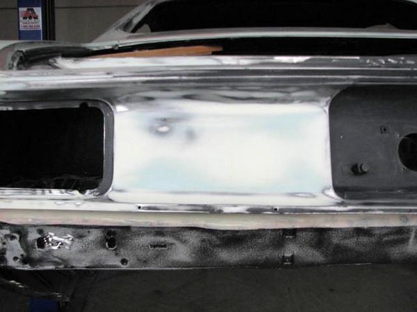 Dent repair to tail light panel.