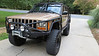 What's been done to this Jeep?<br /> TNT high clearance long arm kit<br /> RSOR Cage <br /> RSOR Heavy Duty Steering including tie rod, drag link, and track bar<br /> RSOR Rocker Replacements<br /> RSOR 231 Tcase Swap<br /> RSOR installed 6 inch BDS coils and Rubicon Express Leaf Springs<br /> RSOR front bumper<br /> Daystar rear bumper<br /> Rustys Gas Tank Skid<br /> Frame Stiffeners<br /> Shackle Relocation Brackets<br /> Thor corner guards<br /> Warn M8000 Winch with in cab winch controls and heavy duty wiring<br /> Ford 8.8 Rear with solid diff cover, aussie locker and 4:56 gears<br /> High Pinon dana 30 front with chromolly shafts, aussie locker 4:56 gears and rockcrusher diff cover