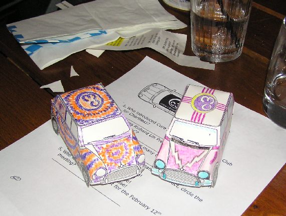 """Rick (left) and Wendy's (right) paper Minis were entered in a contest at the welcome dinner organized by the Southern California-based """"c3 Club."""" It is """"The explosive new MINI group whose number one aim is to raise money and awareness for charitable causes while having a blast with their MINI Coopers.""""  Wendy's cut-out paper and crayon Mini took first place in the """"Best MINI"""" category! The dinner/fundraiser was great fun and raised money for Autism research. See  <a href=""""http://www.c3club.org"""">http://www.c3club.org</a>."""