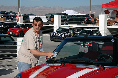 None other than Chuck putting the finishing touches on his Cabrio. Notice the nice, new bonnet stripes.