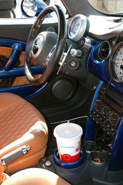 Another MINI setup for racing. This one doesn't have a conventional shifter. Notice the paddle shift levers on the steering wheel. Also notice that there is no shift lever on the console, which now functions as a Big Gulp-size drink holder. The car has a standard transmission (not automatic). See next photo.