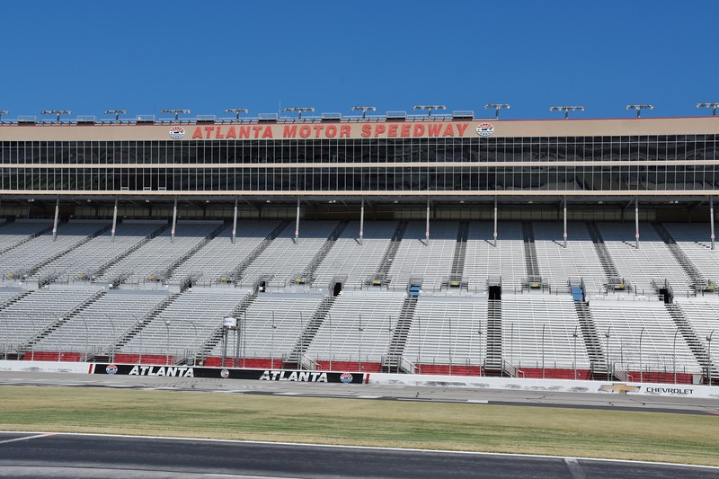 In 1997 the configuration of the track was changed from oval to quad-oval. The project made the track one of the fastest on the NASCAR circuit. ..Exiting turn 4 is the trickiest part of the track. Steering wheel turned hard to left on exit and you straighten wheel and immediately you have to turn the wheel left again. then back to center. Then back left again for turn 1. ..Of course you have a bump in the track at exit of turn 4. Kinda gives the car a bounce.