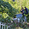 Aldrich Towing uses their rotator truck along with members of the Fitchburg Fire Department worked to free a Suzuki Grand Vitara after backing over an embankment near 293 Arn How Farm Road in Fitchburg on Tuesday afternoon. SENTINEL & ENTERPRISE / Ashley Green