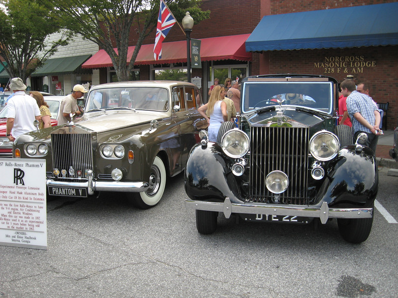 Car on left is a 1957 Phantom V, a prototype limousine that Rolls Royce used for various things for five years before selling to a customer.  Click on picture and select size 'O' to read details on the placard.