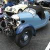 Three-wheeler's top is more like a parka-hood than an automotive roof.
