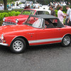 Sunbeam Tiger.  Red Tigers are all I ever see at shows.  I should get myself a racing green Alpine just to spite them!