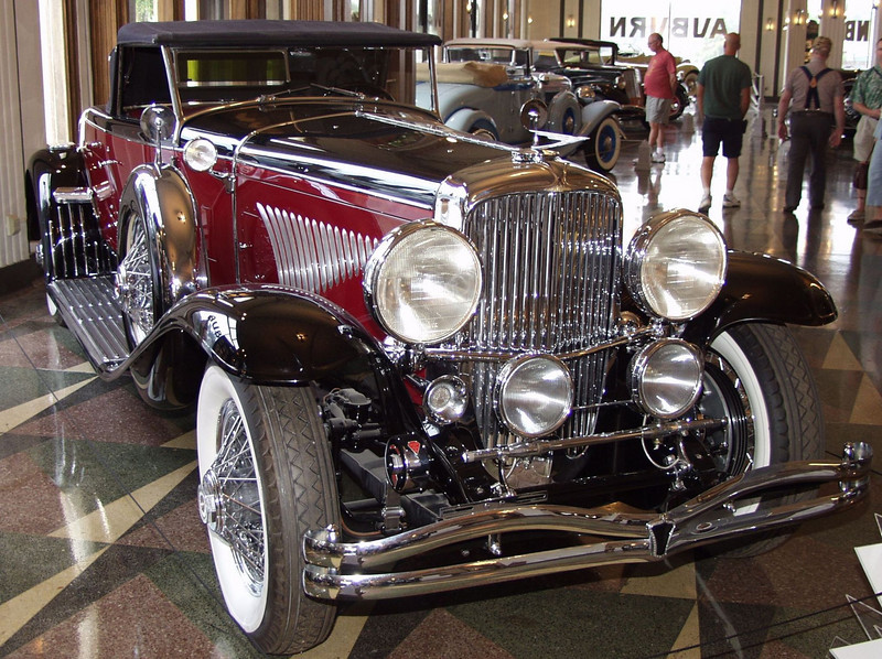 """This magnificently restored Duesenberg features a Murphy body on the long wheelbase chassis. The Walter M. Murphy Company of Pasadena, California built more than 140 bodies for the Model J Duesenberg chassis; far more than any other body builder. The Murphy Convertible Coupe was the single most popular body built for the Model J Duesen berg. A Murphy desiqned body was part of the first Duesenberg offering at the Auto Salon held in New York in December, 1928. In all sixty were produced with most of them mounted on the """"short"""" chasis at 142.5 inches. The most famous variation of the Murphy Convertible Coupe body, was the disappearing top which is featured on this vehicle. When the top is down it is stowed under the deck lid so that none of the fabric or folding mechanisim is visible."""
