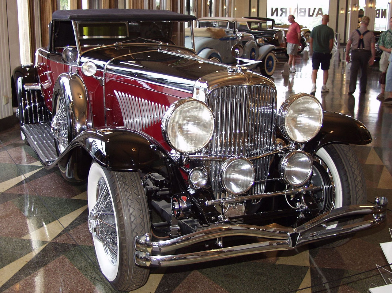 "This magnificently restored Duesenberg features a Murphy body on the long wheelbase chassis. The Walter M. Murphy Company of Pasadena, California built more than 140 bodies for the Model J Duesenberg chassis; far more than any other body builder. The Murphy Convertible Coupe was the single most popular body built for the Model J Duesen berg. A Murphy desiqned body was part of the first Duesenberg offering at the Auto Salon held in New York in December, 1928. In all sixty were produced with most of them mounted on the ""short"" chasis at 142.5 inches. The most famous variation of the Murphy Convertible Coupe body, was the disappearing top which is featured on this vehicle. When the top is down it is stowed under the deck lid so that none of the fabric or folding mechanisim is visible."