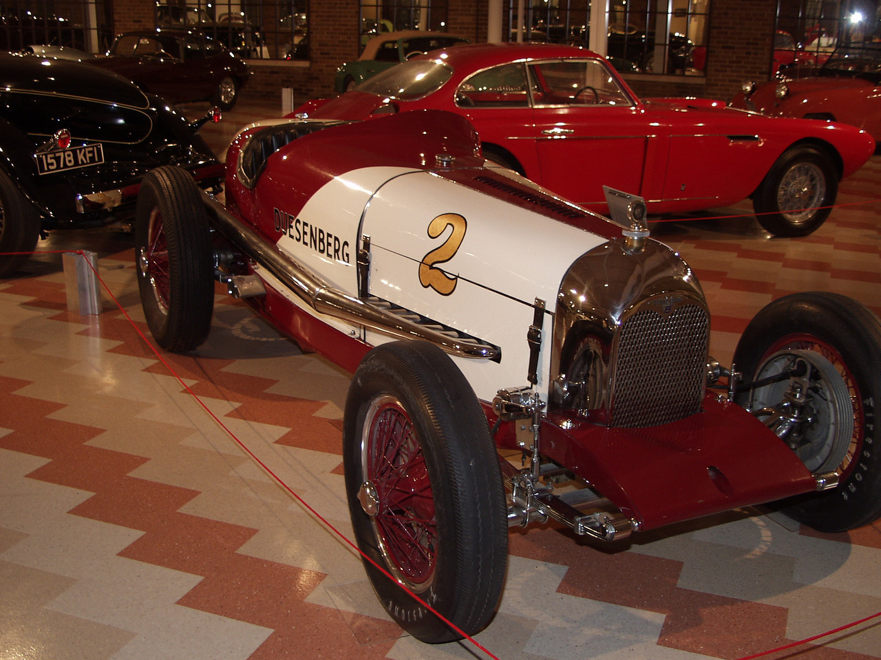 In its day the Duesenberg was an awesome force in the world of racing. In 1921 Duesenberg won the French Gran Prix at Le Mans as the first American entrant to win that prestigious race. From 1913 to 1937  Duesenbergs were raced in the Indianapolis 500.  In the 1922 race, eight of the first ten finishers were Duesenbergs, including the winner. This Duesenberg Indianapolis race car was first driven at the Indianapolis 500 in 1927 and was raced in various forms until 1937. In 1929 the car was part of the Duesenberg factory team and placed third with Jimmy Gleason behind the wheel. If not for some bad pit work at lap 195 it could have won the race. This car was the last Duesenberg to race in the Indianapolis 500 finishing 11th in 1937.<br /> This 1927 Duesenberg race car is powered by a 91.5 cubic inch straight-eight engine with dual overhead cams. In 1927, the fifteen millionth Ford Model T rolled off the assembly line. Babe Ruth hit a record 60 home runs during a 154 game season. Charles Lindbergh became the first man to fly solo across the Atlantic Ocean. <br /> Exhibited through the courtesy of Vintage Racing Motors.