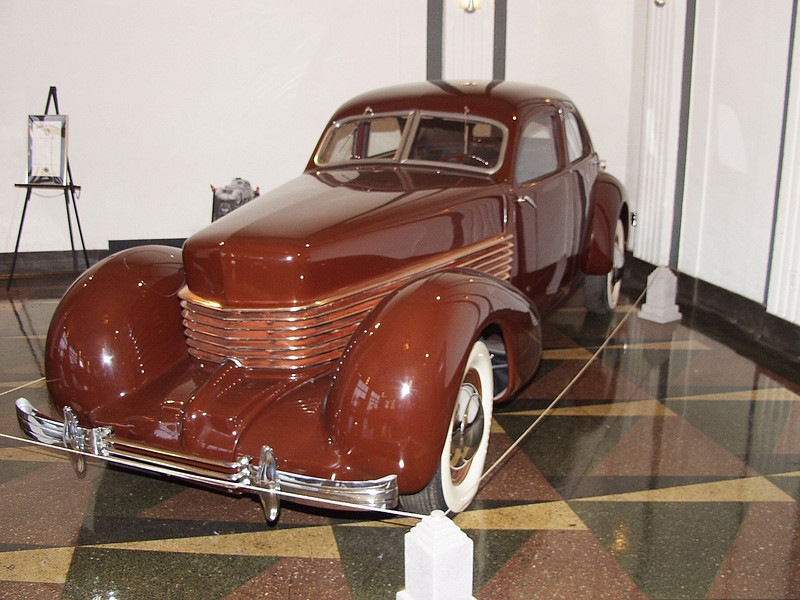When the Auburn Automobile Company decided to proceed with the 810 Cord project, the goal was to exhibit the new vehicle at the 1936 automobile shows. President Roosevelt requested the shows be moved up to mid-November from the scheduled mid-January dates. This meant that Auburn now had only seven and one-half months to get the new Cord ready to exhibit. The Automobile Manufacturing Association only allowed production vehicles to be exhibited. This was defined as a vehicle that had been made in a quantity of at least 100. Auburn attempted to build the 100 needed Cords by hand in 116 days. This is one of the hand built prototypes restored as a show car with copper accents. People stood on the tops of other cars at the shows to get a glimpse of this startling design.