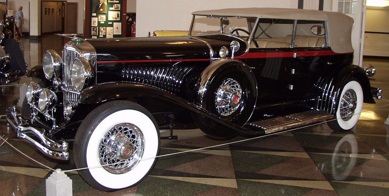 This beautiful automobile features one of the most popular bodies built for the Duesenberg Model J chassis. Thirty-two Convertible Sedans were built by Murphy, most of which like this example having been built on the short Duesenberg chassis. 1932 was an interesting year for Duesenberg. In May, a supercharger was announced for  Duesenberg passenger cars. This boosted the horsepower to 320 horsepower and upped the top speed by an additional ten miles per hour. On July 26, 1932 the automotive world was saddened by the death of engineering giant Fred Duesenberg. He passed away as a result of injuries sustained in an automobile accident. He was only 55 years old. In addition, Harold T. Ames replaced E.L Cord as president of Duesenberg, Inc.<br /> The Duesenberg Model J engine is a modified Lycoming straight eight featuring dual overhead cams and four valves per cylinder. With a displacement of 420 cubic inches, the engine was advertised to produce 265 horsepower. This vehicle sold new for approximately $14,750.
