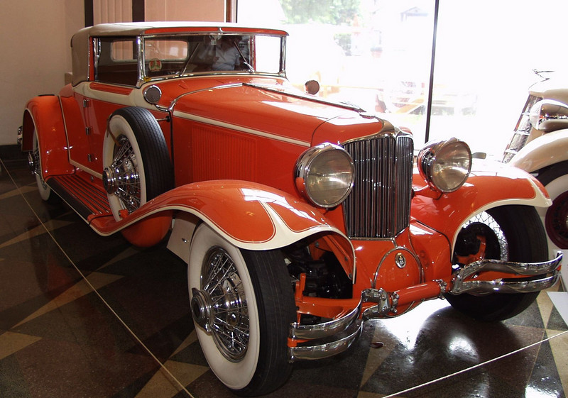 """This 1929 Cord was owned by the Frank Lloyd Wright Foundation. Wright purchased a Cord L-29 Phaeton in 1929.  He had the car painted in rusty orange color, known as """"Taliesen Orange.""""  """"The Cord had taken several foreign prizes for body design and it was nearest thing to a well designed car I had ever seen outside of Europe,"""" said Wright in his autobiography.  """"The Cord seemed to have the right principle, front-wheel drive pulling instead of pushing along.  It certainly looked becoming to my houses.  The best design from my streamline viewpoint ever put on the market.  The Cord was an innovator along right lines that changed the whole field of body design for the better.""""<br /> The 1929 Cord L-29 is powered by a 298.6 cubic inch Lycoming straight eight, which produces 125 horsepower. The wheelbase measures 137.5 inches, and the car weighs 4300 pounds. When new, the Front Drive Cord L-29 Cabriolet cost $3295. <br /> October 24, 1929, panic swept the New York stock exchange as the bottom fell out of the stock market. Popeye the Sailor Man made his comic strip debut in the United States. German automotive pioneer, Carl Benz, died at the age of 84.<br /> Exhibited through the courtesy of Richard V. Munz, Madison, Wisconsin."""