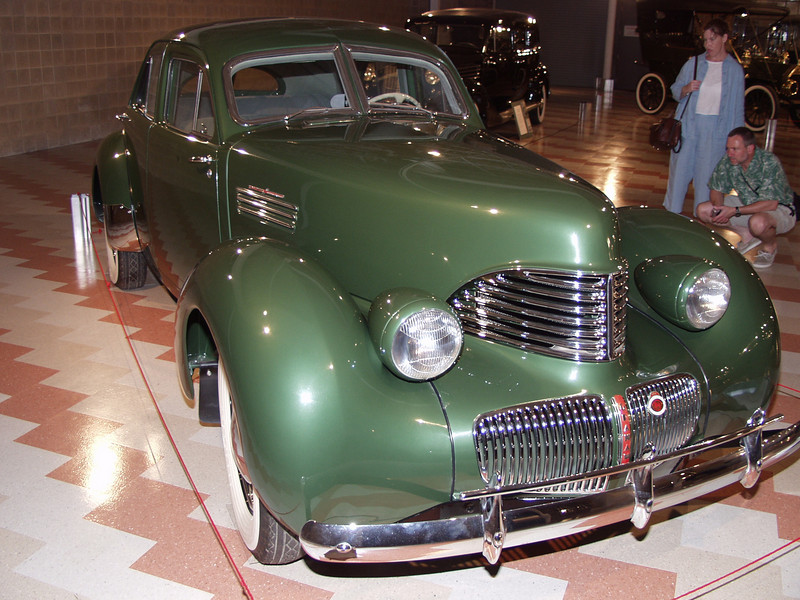 1941 Graham Hollywood Supercharger, best weight to power ratio of any American production car - 25 TO 1.  Top speed over 100 miles per hour.<br /> Graham used the 1937 Cord body dies from The cowl back with a redesigned front end. Several other modifications were made including rain gutters, vent windows, windshield wipers, and  dashboard. While the Cord had featured front wheel drive, the Grahams were driven by the rear wheels. Only 1859 Hollywoods were built with the majority being supercharged. The list price in 1941 was $1,250 for a supercharged model. On the same assembly line that produced the Hollywood, Graham built all 319 production Hupmobile Skylarks under contract. <br /> Hollywoods were raced successfully across the nation by many drivers including Bill France, the father of NASCAR.<br /> Displayed through the courtesy of Ken and Stephanie Dunsire of Fort Wayne, Indiana.