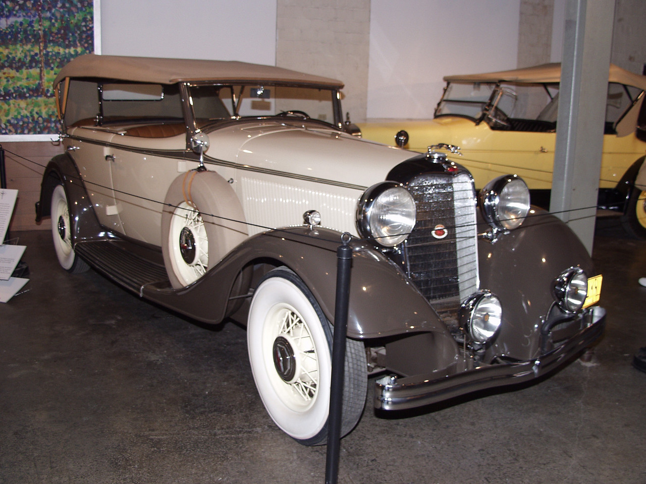 "The KB Lincoln was introduced in 1932 with Lincoln's first production twelve cylinder engine. That year, the KA was brought out with a V-8 engine and priced lower than  Lincoln's previous K models. For 1933 the KA's line was expanded to include 12 different body styles. The series was once again restyled and included the addition of hood louvers and a chrome mesh grille. Also, the V-12 was now  the standard engine for the KA series. Aluminum pistons were used and the crankshaft was carried in four bearings. The detachable cylinder heads were constructed  of cast iron. While the engine for the  KA was based on the KB V-12  it was simpler and less expensive to   manufacture.   A total of twelve KA dual cowl phaetons such as this one were produced in 1933.<br /> The 1933 Lincoln KA Dual Cowl Phaeton is powered by a 448 cubic inch  V12 that produces 150 horsepower. The wheelbase measures 145 inches, and the car weighs approximately 5,500 pounds.<br /> In 1933 Adolph Hitler became Chancellor, then dictator of Germany. The Agriculture Adjustment Act was passed as part of President Franklin D. Roosevelt's ""New Deal"" providing relief to American farmers, especially in the dust bowl areas."