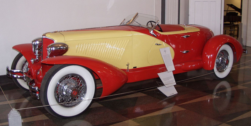 This Cord is an authentic recreation of the 1931 Paris Automobile Show car. The original car was purchased at the Paris Automobile show by Paul Berns, the husband of screen actress Jean Harlow. This vehicle was built using an original Cord chassis and running gear. Every detail of the original is seen in this recreation including door panel bar and humidor. Car collector Dr. Fay Culbreth commissioned Stan Gilliland Kansas to build the vehicle. The coachwork was carefully constructed by Mark Kennison to identically match the vintage Cord. The fate of the original Phil Wright designed speedster is unknown.<br /> The 1931 Front Drive Cord is powered by a 297 cubic inch Lycoming in-line eight-cylinder engine  which produces 125 horsepower. The custom bodied speedster is built on the standard 138 inch wheelbase.<br />  In 1931, the Empire State Building  was completed in New York city. At 1245 feet, it was the tallest building in the world Cartoon crime fighter Dick Tracy appeared in Chicago newspapers.