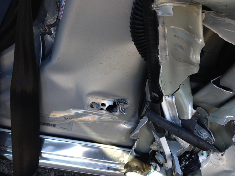 Note unibody frame damage.
