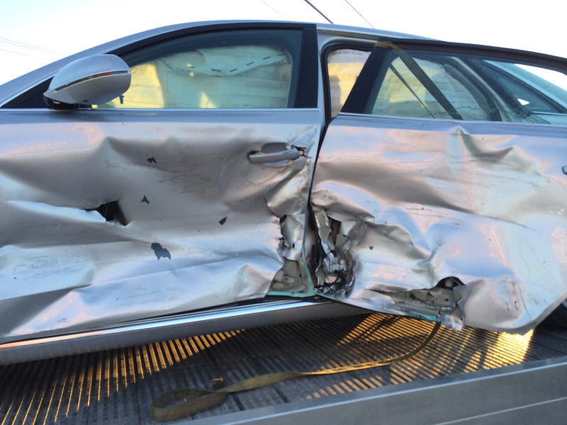 2013 A8L 4.0 after being hit on February 28, 2014. Note side curtain airbags deployed. Significant damage to aluminum frame and bodywork. Dual-pane glass shattered.
