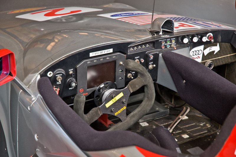 Note the lack of buttons and dials on the steering wheel. This is probably just a display wheel, lest someone walk off with the $10,000+ racing wheel.
