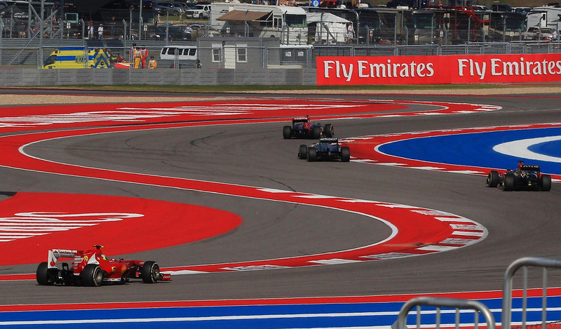 S-turn traffic early in the 2013 U.S. Grand Prix Formula One race at Austin.