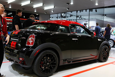 The new MINI Coupe 2-seater as seen with the John Cooper Works package. The top is designed to look like a baseball cap worn backwards.