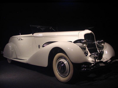 Duesenberg Model SJ Convertible Sedan. Duesenberg's engines won the horsepower wars of the 1920s and 1930s, thanks to solid engineering. In 1932, they upped the ante by supercharging their engines to 320hp. This was at a time when other manufactuers struggled to make more than 200, even with superchargers.  This supercharged model features a striking body by Bohmann & Schwartz of California.