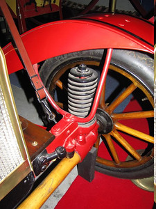 Brush (1910). One of the first uses of a coil spring on a car.
