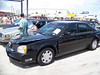 """LotNumber 949             SOLD $7,500<br /> Year 2000 <br /> CarMake CADILLAC <br /> CarModel DE VILLE <br /> CarStyle VITO'S FROM """"THE SOPRANOS"""" <br /> ExteriorColor NAVY BLUE <br /> Interiorcolor   <br /> Cylinders   <br /> Engine   <br /> Transmission   <br /> Summary Utilized by the character Vito Spatafore in the award-winning HBO series """"The Sopranos"""". Vito used the vehicle in """"Moe N' Joe"""". Special conditions apply. <br /> Description This black Cadillac DeVille was utilized by the character Vito Spatafore in the award-winning HBO series """"The Sopranos"""". Vito used the vehicle in """"Moe N' Joe"""" (Season 6 Part I, Episode 10) during the scene where Vito accidentally rear ends a parked Jeep Wagoneer and then kills the owner of the other car rather than report the accident. The fully functional vehicle has approximately 93,541 miles on the odometer and is in good screen used condition with minor front end damage as seen in the episode. **This vehicle is the actual vehicle used on the award-winning HBO drama, """"The Sopranos"""" and it is in screen-used condition. There is no claim that the vehicle works properly and it is being sold under special conditions.**"""