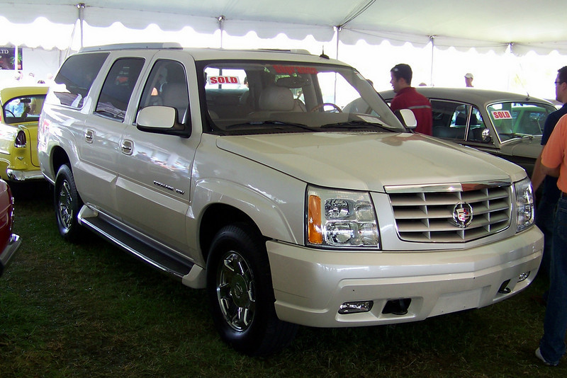 "LotNumber 633 SOLD $45,000<br /> Year 2003 <br /> CarMake CADILLAC <br /> CarModel ESCALADE ESV <br /> CarStyle TONY SOPRANO'S FROM THE SOPRANOS <br /> ExteriorColor WHITE <br /> Interiorcolor BEIGE <br /> Cylinders   <br /> Engine   <br /> Transmission   <br /> Summary Utilized by the character Tony Soprano in the award-winning HBO series ""The Sopranos"". This vehicle was Tony's primary car used in the last three seasons of the series. Special conditions apply. <br /> Description This fully equipped white 2003 Cadillac Escalade was used by the character Tony Soprano portrayed by actor James Gandolfini in the last three seasons of HBO's award winning series ""The Sopranos"". This vehicle appeared in numerous episodes and was a prominent signature piece from the hit show. Die-hard fans will certainly be familiar with this car from its extensive use on the production. Some may recall pivotal moments involving the car, such as the scene in ""The Second Coming"" (Season 6 Part 2, Episode 7) when Tony pulls up in the driveway of the Soprano home shortly before discovering his son A.J. on the verge of drowning in the family pool following an unsuccessful suicide attempt, or perhaps the climactic chase sequence in ""In Camelot"" (Season 5, Episode 7) when Tony jumps into the Escalade and chases Phil Leotardo through the streets of New Jersey, eventually running his nemesis's car into the back of a parked truck. The vehicle is equipped with clear windshields for exterior filming and was also occasionally fitted with external camera rigging to facilitate interior filming during the production. Many key plot conversations took place in the vehicle, and it was Tony's primary source of transportation when conducting business on behalf of the Soprano family in the latter half of the series. Perhaps most astounding of all given its owner's reputation is the fact that the vehicle is in excellent condition and was never crashed, shot, or blown up. This shirt was worn by the character Tony Soprano played by actor James Gandolfini in H.B.O.'s award winning series ""The Sopranos"". Mr. Gandolfini wore the shirt in ""In Camelot"" (Season 5, Episode 7) during the scene where Tony pursues Phil Leotardo in the Escalade and forces him to run into the back of a parked truck. This garment is part of Mr. Gandolfini's personal collection of Tony Soprano wardrobe that he acquired after the Sopranos series ended. This shirt represents the signature Tony Soprano look and is complete with the original production tag. Accompanied by a certificate of authenticity signed by issued and signed by James Gandolfini. The shirt has been donated by The Golden Closet and TheGoldenCloset.com. **This vehicle is the actual vehicle used on the award-winning HBO drama, ""The Sopranos"" and it is in screen-used condition. There is no claim that the vehicle works properly and it is being sold under special conditions.**"