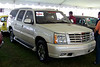"""LotNumber 633 SOLD $45,000<br /> Year 2003 <br /> CarMake CADILLAC <br /> CarModel ESCALADE ESV <br /> CarStyle TONY SOPRANO'S FROM THE SOPRANOS <br /> ExteriorColor WHITE <br /> Interiorcolor BEIGE <br /> Cylinders   <br /> Engine   <br /> Transmission   <br /> Summary Utilized by the character Tony Soprano in the award-winning HBO series """"The Sopranos"""". This vehicle was Tony's primary car used in the last three seasons of the series. Special conditions apply. <br /> Description This fully equipped white 2003 Cadillac Escalade was used by the character Tony Soprano portrayed by actor James Gandolfini in the last three seasons of HBO's award winning series """"The Sopranos"""". This vehicle appeared in numerous episodes and was a prominent signature piece from the hit show. Die-hard fans will certainly be familiar with this car from its extensive use on the production. Some may recall pivotal moments involving the car, such as the scene in """"The Second Coming"""" (Season 6 Part 2, Episode 7) when Tony pulls up in the driveway of the Soprano home shortly before discovering his son A.J. on the verge of drowning in the family pool following an unsuccessful suicide attempt, or perhaps the climactic chase sequence in """"In Camelot"""" (Season 5, Episode 7) when Tony jumps into the Escalade and chases Phil Leotardo through the streets of New Jersey, eventually running his nemesis's car into the back of a parked truck. The vehicle is equipped with clear windshields for exterior filming and was also occasionally fitted with external camera rigging to facilitate interior filming during the production. Many key plot conversations took place in the vehicle, and it was Tony's primary source of transportation when conducting business on behalf of the Soprano family in the latter half of the series. Perhaps most astounding of all given its owner's reputation is the fact that the vehicle is in excellent condition and was never crashed, shot, or blown up. This shirt was worn by the character Tony"""