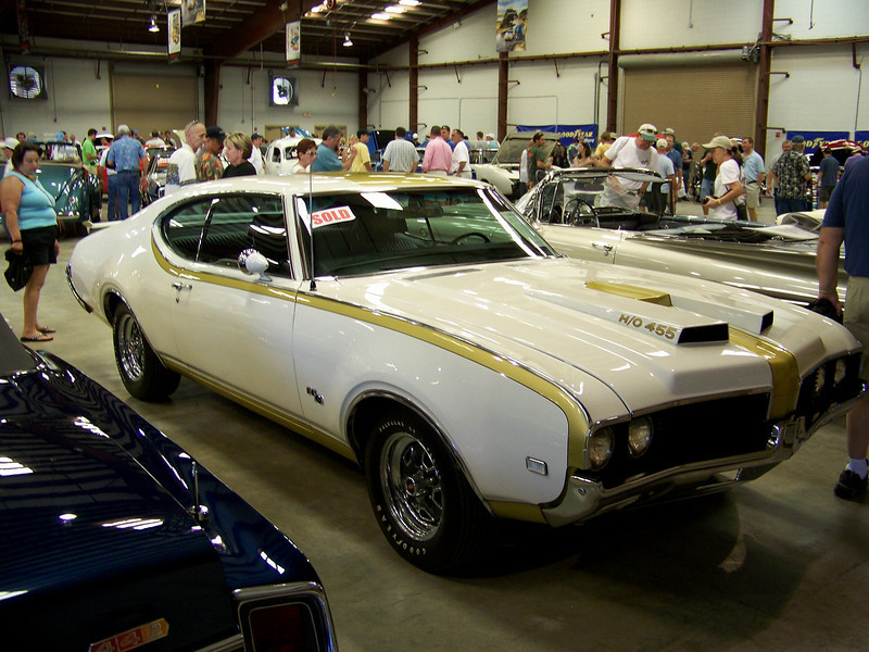 LotNumber 639.1 SOLD $115,000<br /> Year 1969 <br /> CarMake OLDSMOBILE <br /> CarModel HURST <br /> CarStyle 2 DOOR HARDTOP <br /> ExteriorColor WHITE W/GOLD STRIPES <br /> Interiorcolor BLACK <br /> Cylinders 8 <br /> Engine 455 <br /> Transmission 3-SPEED AUTOMATIC <br /> Summary Full documentation and owner history. An all numbers matching '69 Hurst Olds with a full restoration. Rally Pack gauges, power steering, power front disc brakes, Hooker headers and original exhaust manifolds. <br /> Description An all numbers matching '69 Hurst Olds with a full restoration. 906 of these limited production cars were produced. This car is one of roughly 304 that were equipped with air conditioning. This all numbers matching car has had a rotisserie frame-off restoration. Protect-O-Plate, Build Sheet and Broadcast Card with full documentation and complete owner history. Rally Pack gauges, power steering, power front disc brakes, Hooker headers and original exhaust manifolds that go with the car.