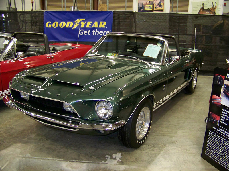 "LotNumber 677.1   SOLD $87,000<br /> Year 1968 <br /> CarMake SHELBY <br /> CarModel GT350 <br /> CarStyle CONVERTIBLE <br /> ExteriorColor HIGHLAND GREEN <br /> Interiorcolor BLACK <br /> Cylinders V8 <br /> Engine 302 <br /> Transmission 4-SPEED <br /> Summary A one owner since new car with the rare all option, factory air conditioning package. Extensive 2 year restoration just completed. <br /> Description This is a one owner since new 1968 Shelby GT350 convertible. It has just undergone an extensive two year refurbishing. Less than 200 miles since complete overhaul on engine and transmission. 1 of 404 built. One of a very few with the rare factory air conditioning package. New Highland Green paint Code ""4869"" matched to that year with white racing stripes. New black interior, white convertible top with dual pane glass window, new 10-spoke rims, Goodyear Polyglas tires, Koni adjustable shocks, sequential tailights, tilt away power steering, power brakes, California fog lights, roll bar, electric top controls, brake scoops, AM radio, console and glovebox. Factory undercoated and garage kept."