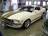 LotNumber 682.1 SOLD $66,000<br /> Year 2007 <br /> CarMake FORD <br /> CarModel MUSTANG GT <br /> CarStyle CUSTOM FASTBACK <br /> ExteriorColor WHITE <br /> Interiorcolor TAN <br /> Cylinders 8 <br /> Engine 4.6 LITER <br /> Transmission AUTOMATIC <br /> Summary One-of-a-kind retro-styled Mustang GT built as a tribute to the Holman Moody racing legacy. Built with full approval and input of Lee Holman of Holman Moody. Retro-styled with '68 Mustang sheet metal and tons of performance upgrades. <br /> Description This is a one-of-a-kind custom Mustang GT built as a tribute to the Holman Moody racing legacy. This car was built with full support and input from Lee Holman of Holman Moody. The car was customized with reproduction steel body panels for the '68 Mustang to give it a classic and unique retro look. The fenders, doors, quarters and hood are grafted steel for a long life of enjoyable driving. The original door handles were replaced with '68 Mustang-style chrome mechanical handles and mated with the internal locking mechanisms to provide seamless functionality. True to Holman Moody heritage, this car is loaded with performance upgrades that make it a true competitor on the street or track. A Super-charger, special suspension and other performance modifications were all performed by the professionals at Tulsa Car FX. The detailed features of this car must be seen to be believed. Each inspection will reveal more classic details. The steel construction and quality craftsmanship make this a car that can be driven and enjoyed for years to come. As a one-of-a-kind sanctioned Holman Moody tribute car, this car will delight any enthusiast.