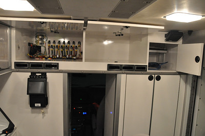 This is the storage on the front with the doors open. They used one for many of the electrical components for all of the equipment in the vehicle. That cabinet is not used for storage. The vents below are from the AC and heat controlled from the driver's seat so that the temperature can be controlled without running the generator.