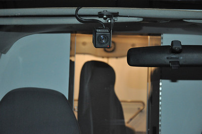 This is the camera in the front windshield that we use to record SFSTs at our checkpoints. Works well on the front away from the generator noise. The camera is operated by remote control with the microphone box so that officers do not have to get in and out of the vehicle to start and stop the video every time.