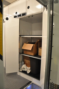 This is a storage cabinet just inside the main entrance. The empty shelf holds our instrument when it is being stored or in long transit. There is additional storage above in the smaller compartments.