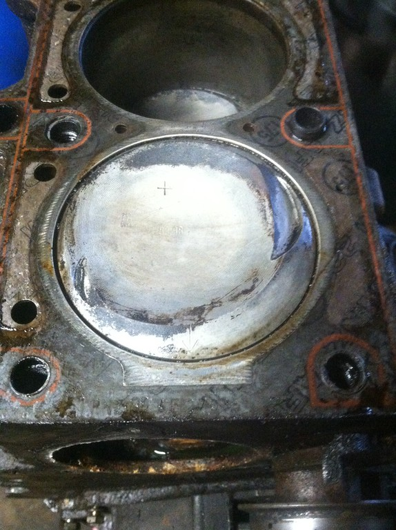 cyl 1. wiped clean with a rag. the pistons are so clean that I suspect they were removed and media blasted during the previous rebuild (or just cleaned well with the head off).