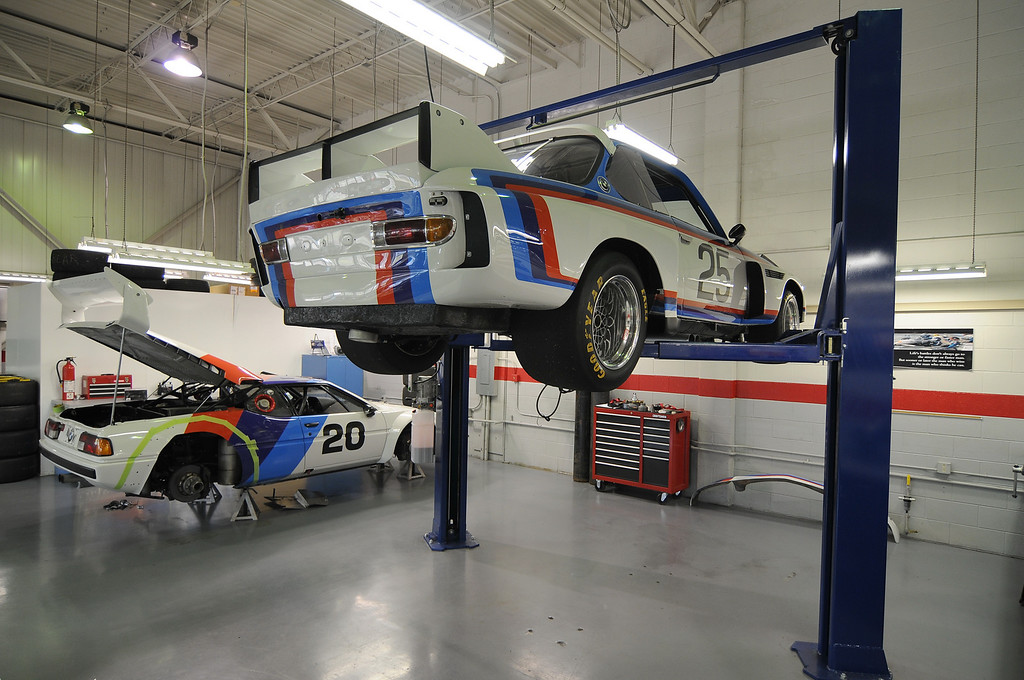 1975 3.5 CSL on lift, 1980 M1 Procar on the jackstands.