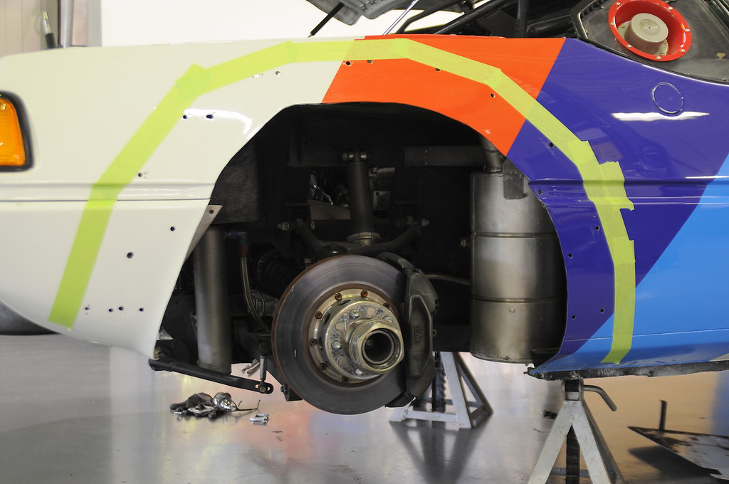 Work detail of 1980 M1 Procar. Tape and holes outline where fender attachment is mounted.