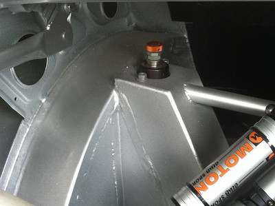 E30 M3 with S85 V10 conversion. This is the rear trunk detail showing the extent of the re-worked chassis. New fenders were cut for the wider rear wheels. The basic E90 suspension was used with the shock mounts re-located for the Moton shocks.