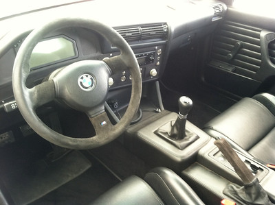 E30 M3 with S85 V10 conversion. Interior showing how stock this car is - stock dash layout (with Pectel screen), stock door panels, full leather trimmed center console and seats. What you don't see in this picture is the full rollcage built into the doorsills and B-pillar. The aluminum knobs for the A/C and throttle settings are a beautiful touch.