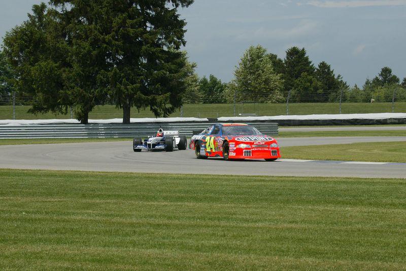 BMW-Williams F1 car (Jeff Gordon) and Hendrick Motorsport Chevrolet Monte Carlo (Juan Pablo Montoya