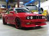 E30 M3. Long list of work, including 3.0 liter US S50 engine, Forgeline wheels, Evo front and rear spoilers.