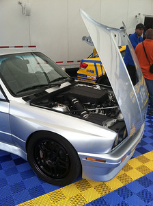 E30 M3 with S85 V10 conversion. This car is simply awesome. It looks like an E30 M3 but the chassis has been reworked to accept E90 front and rear subframes, suspension pickups, and brakes. V10 engine with 6-speed manual and Pectel engine management. I drove this car and it's wicked fast but entirely driveable on the street.