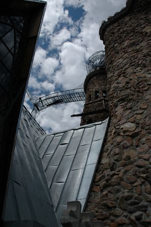 Steeply pitched roofline, near the right tower.